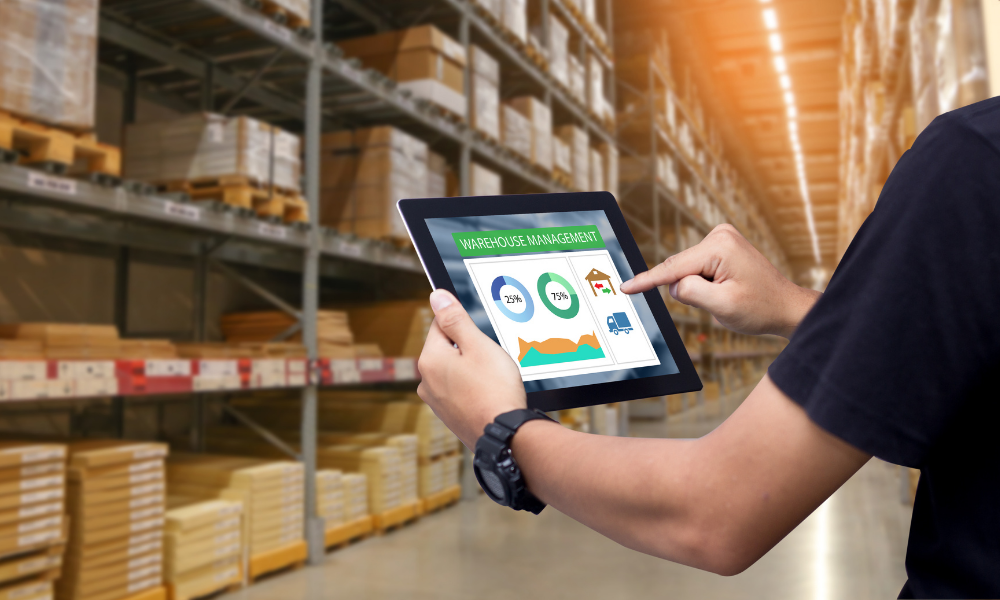 Man in warehouse holding tablet device