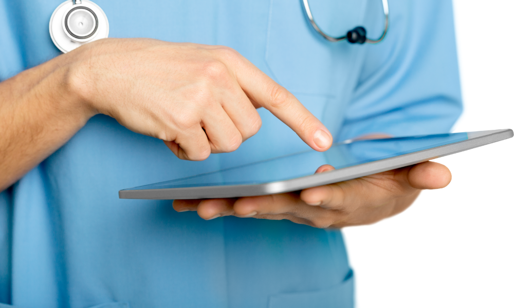 Healthcare professional holding tablet device